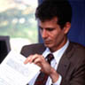 photo of man reading document